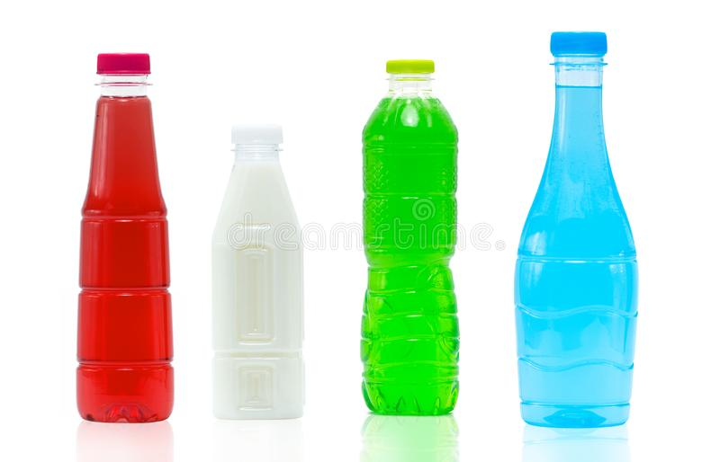 Soft drink in plastic bottle and cap with modern packaging design on white background with blank label. Blue color beverage bottle. Container. Carbonated drinks royalty free stock photos