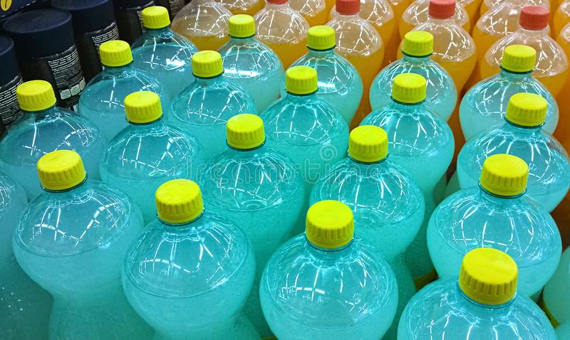 Soft drinks bottles meticulously aligned in a supermarket.  stock images