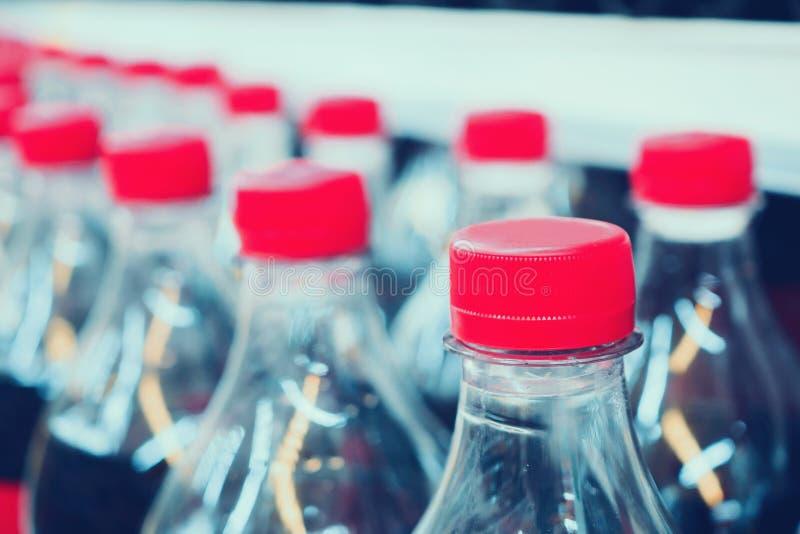 Soft drinks bottles on shelves in supermarket. Store royalty free stock photo
