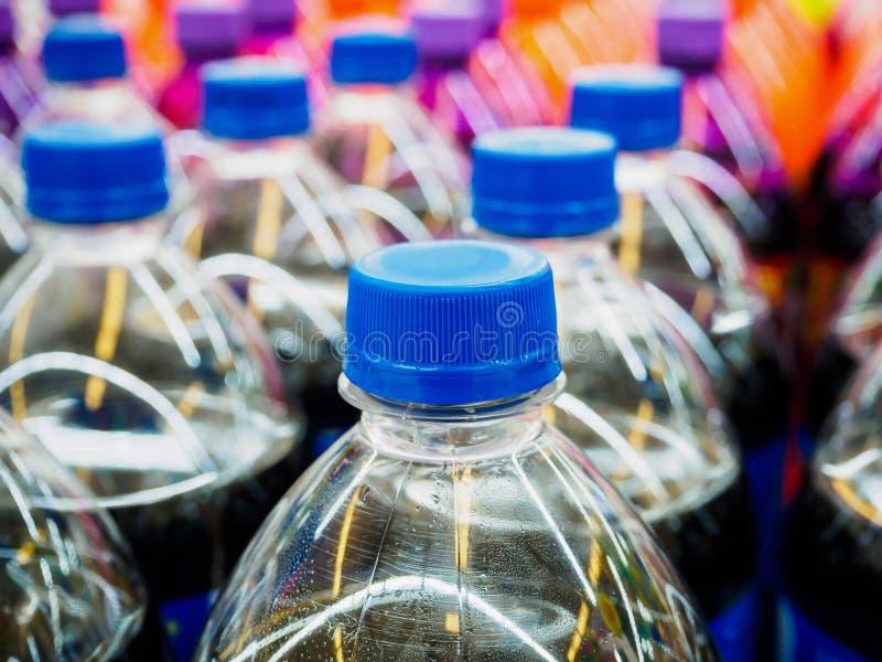 Soft drinks bottles. In supermarket stock photography