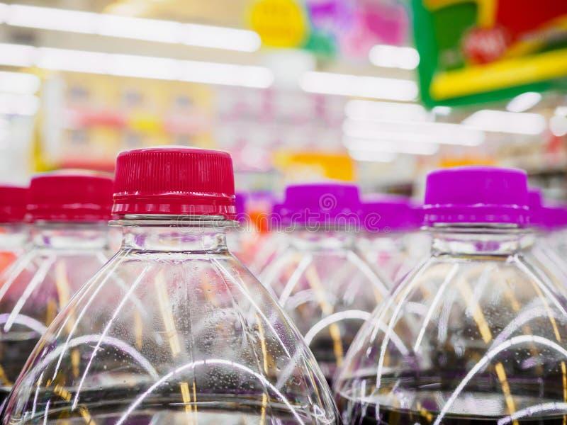 Soft drinks bottles. In supermarket royalty free stock image