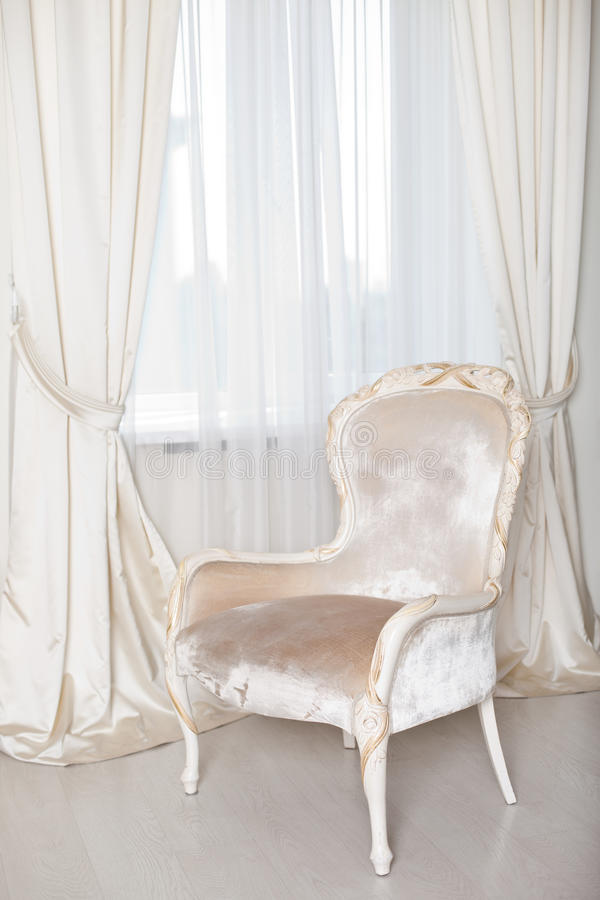 Soft elegant armchair near the window royalty free stock photos