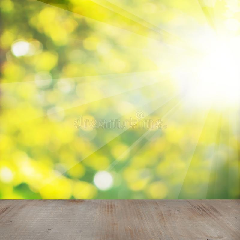 Soft Focus Background with Abstract Green and Yellow Bokeh Light. And Gray Wood Texture with Copy space royalty free stock photography