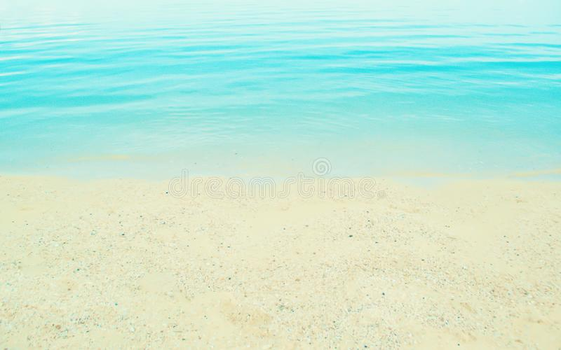 Soft focus blue sea and sand beach background royalty free stock image