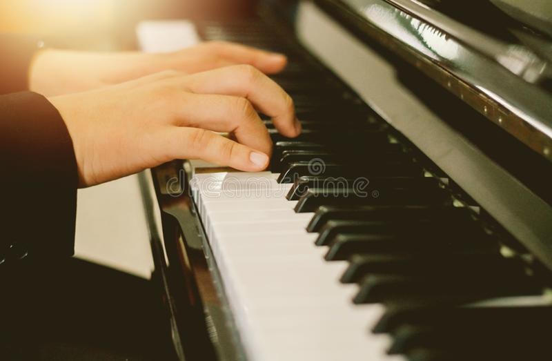 Soft focus, blurr Playing piano with light sunset background.and instagram style filter photo vintage. Tone royalty free stock photo