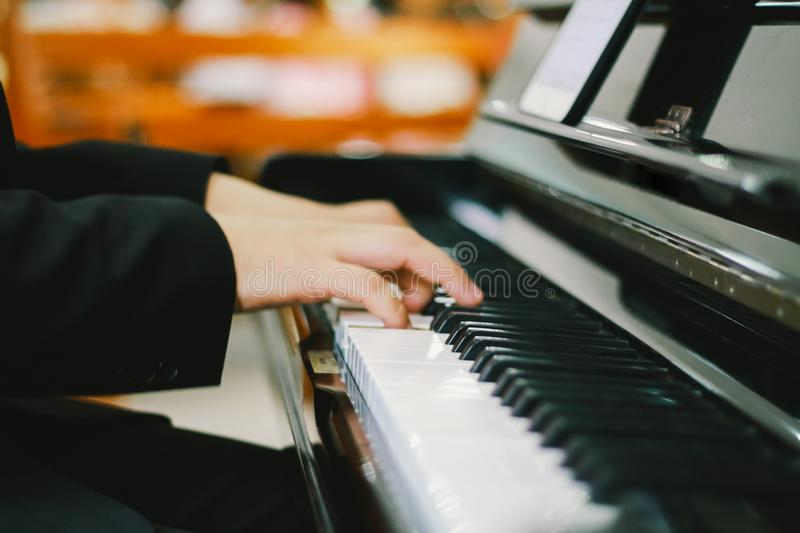 Soft focus, blurr Playing piano with light sunset background. And instagram style filter photo vintage tone stock images