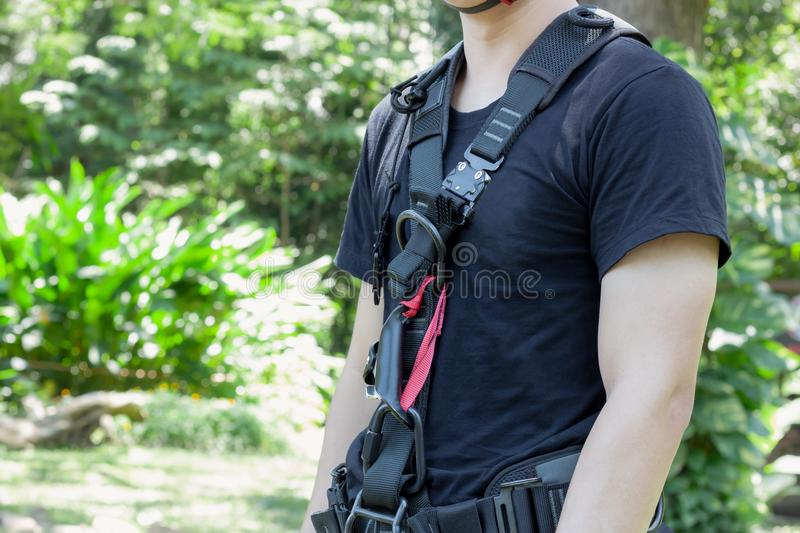 Soft focus close up young man Asian wear the safety harness for job at high critical hazard area. Work safe background concept.Soft focus close up young man stock photo