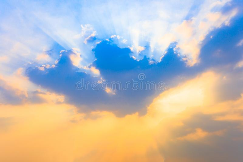 Soft focus on cloud and Sunlight Sunbeam or Sunray through the blue sky at sunset or evening time. stock photos
