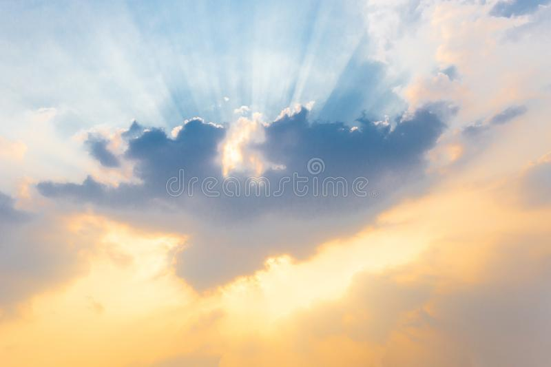 Soft focus on cloud and Sunlight Sunbeam or Sunray through the blue sky at sunset or evening time. Amazing clouds stock image