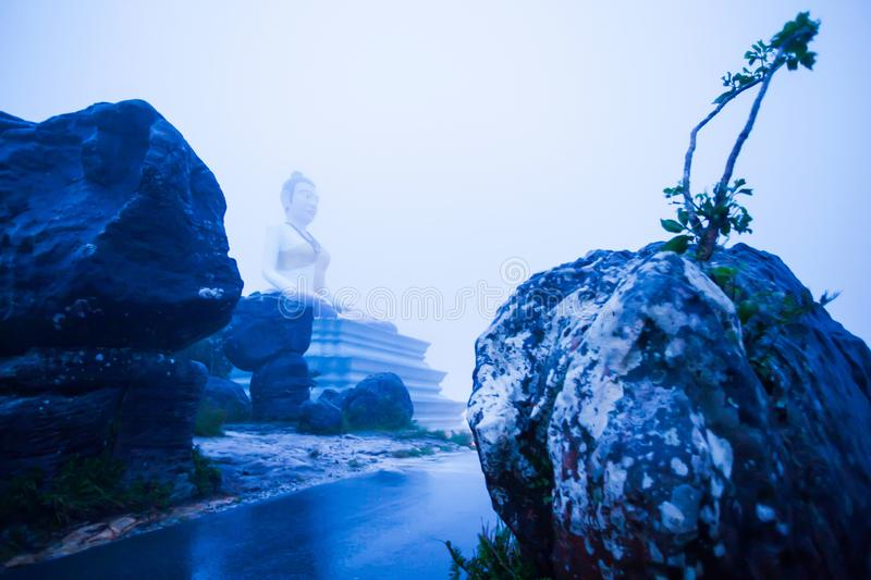 Fantastic landscape of Lok Yeay Mao Monument in foggy, the monument was constructed atop Bokor Mountain, Kampot, Cambodia. Soft focus, fantastic landscape of Lok royalty free stock photo
