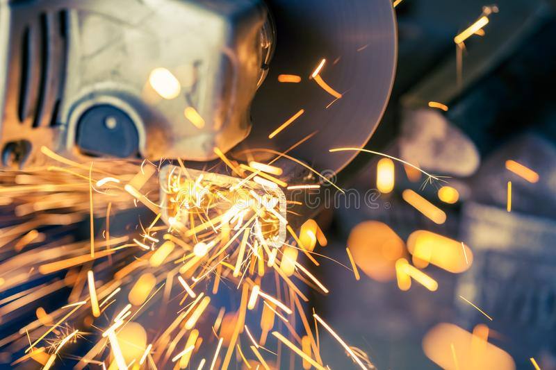 Soft focus with sparks flying from metal being cut with electric grinder stock photo