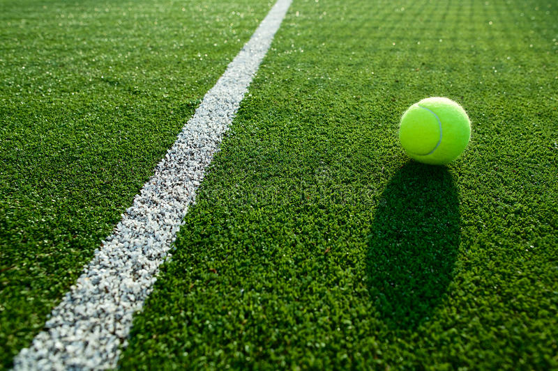 Soft focus of tennis ball on tennis grass court good for backgro royalty free stock images