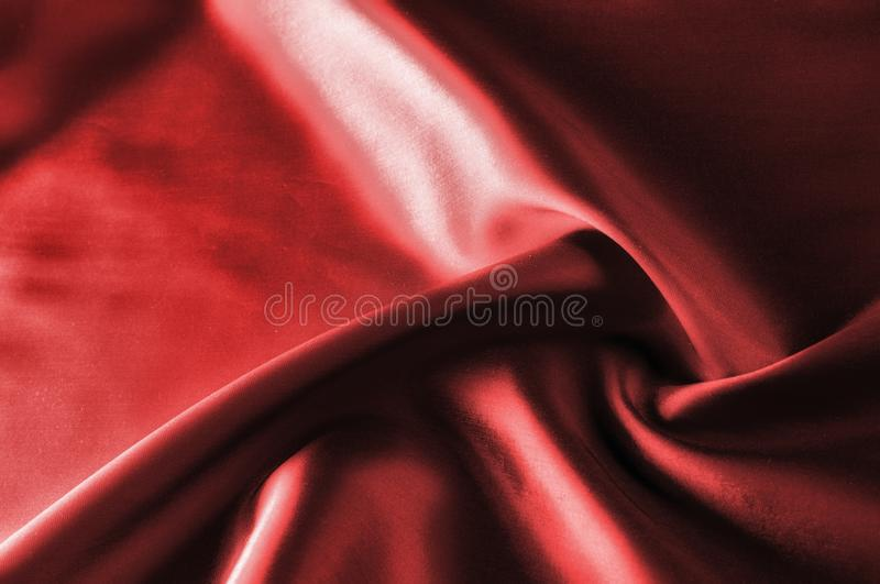 Soft focus. texture, pattern. cloth silk red. it is a light smo. Oth drape that promotes movement. Thin and light, add a delicious piece to your autumn-winter royalty free stock photography