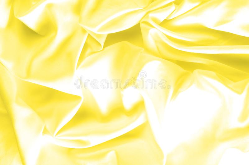 Soft focus. texture, pattern. fabric silky yellow, solar Golden. Yellow silk feil. Like the body to the taffeta, it has a smooth arm that creates a subtle sheen stock image