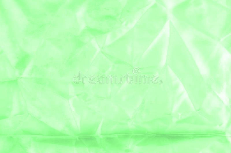 Soft focus. texture, pattern. green silk fabric. Emerald. Update. Your exquisite design with this Carolina stone green silk feil. it has a smooth hand that stock photography