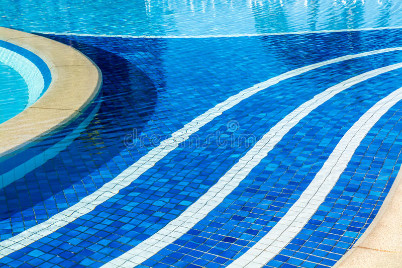 Soft focus water surface, sun light reflect. Water wave outdoor swimming pool royalty free stock images