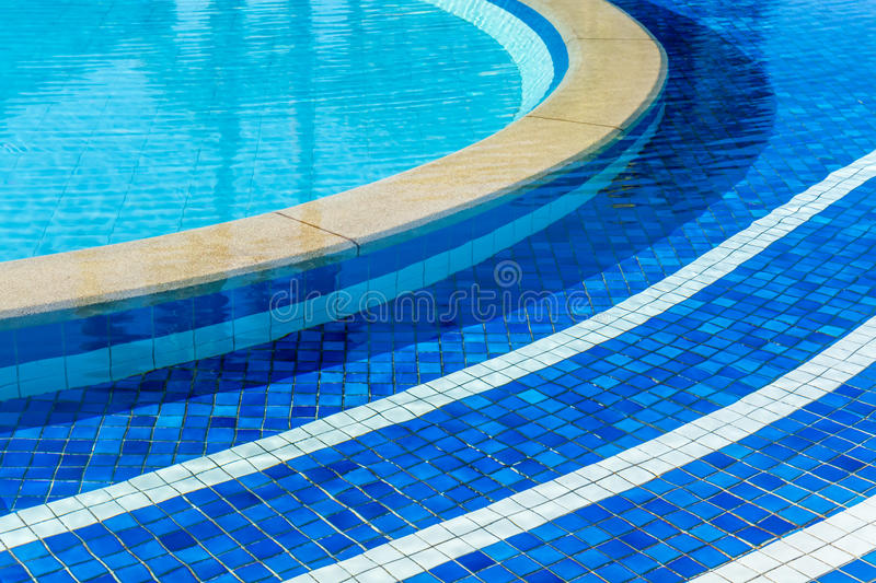 Soft focus water surface, sun light reflect. Water wave outdoor swimming pool stock photo