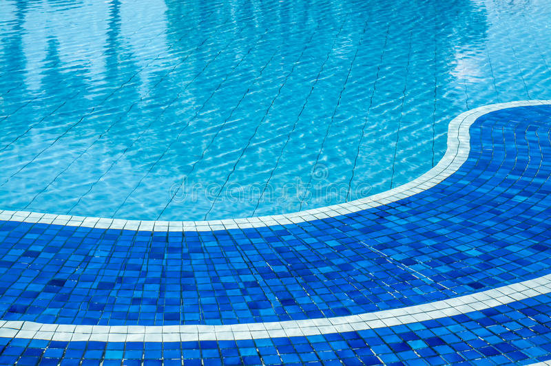 Soft focus water surface, sun light reflect. Water wave outdoor swimming pool royalty free stock photos