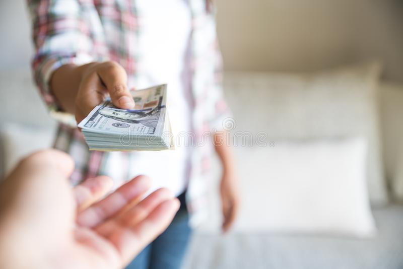 Soft focus on woman hands proposing money us dollar bills. To you royalty free stock photography