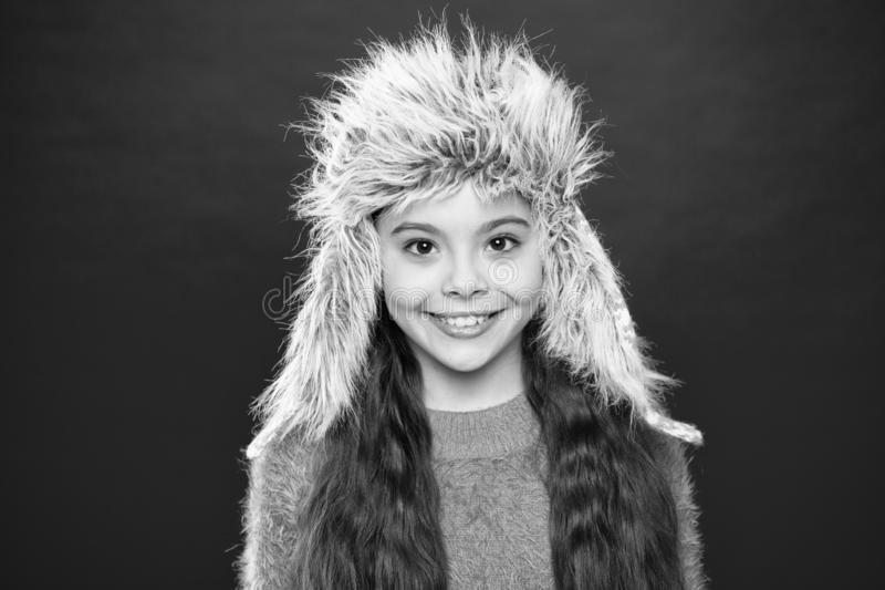 Soft furry accessory. Tips for caring for fur garments. Child long hair soft hat enjoy softness. Winter fashion concept. Warm hat for cold weather. Kid girl royalty free stock photos