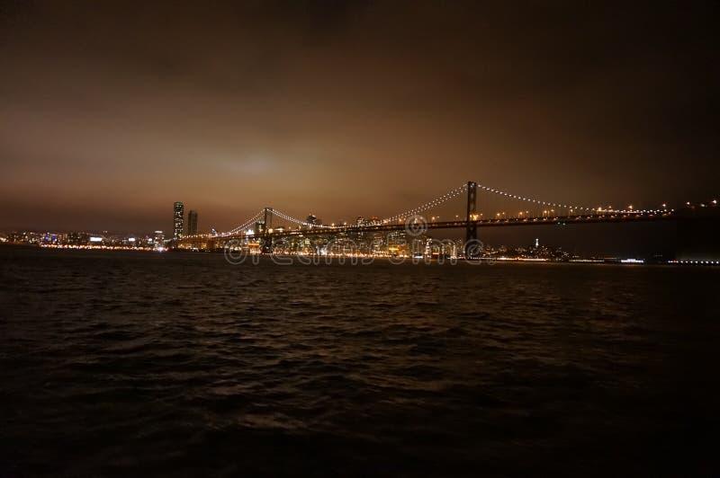 San Francisco City through the Bay Bridge at night stock images