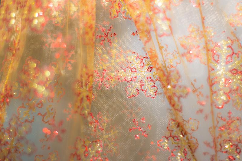 Soft glowing golden yellow festive background. Colored abstract blurry backgrounds. New Year`s and Christmas royalty free stock photos