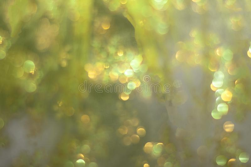 Soft glowing golden yellow festive background. Colored abstract blurry backgrounds. New Year`s and Christmas stock image