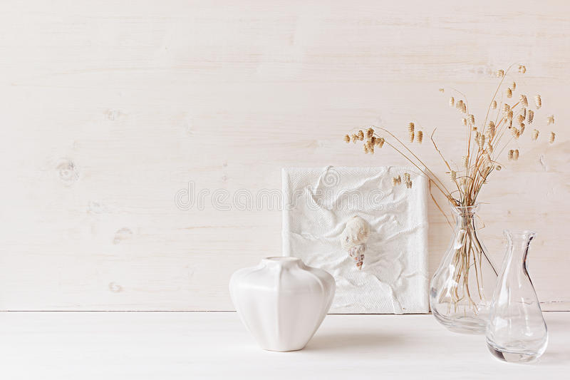 Soft home decor. Seashells and glass vase with spikelets on white wood background. royalty free stock photo