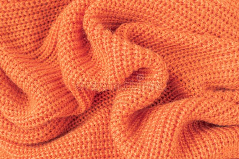 Soft knitted fabric from orange fluffy yarn. royalty free stock images
