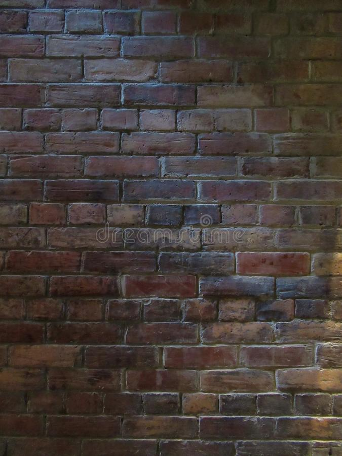 Soft light in a brick wall stock images