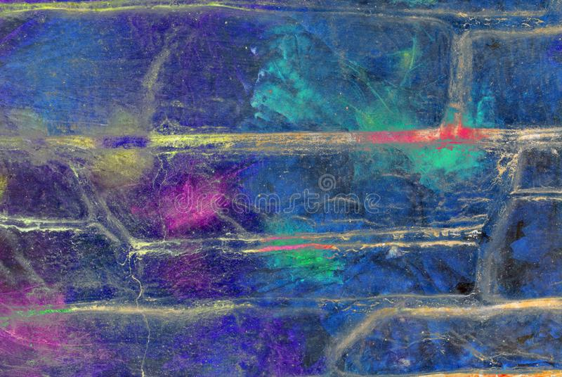 Mixed media artwork, abstract colorful artistic painted layer in blue color palette with purple, green splashes on grunge brick royalty free stock images