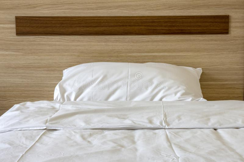 Soft pillow on a comfortable wood bed. Bedroom Interior. Front view stock images