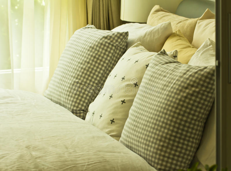 Soft pillows on the bed royalty free stock photos