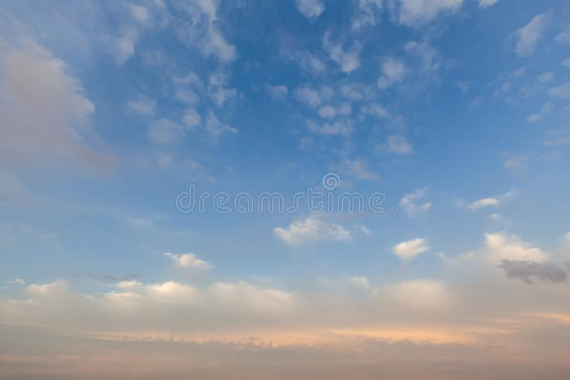 Soft pink cloudscape sunset 0026. Soft pink cloudscape at sunset in the UK over Norfolk. Blue sky and white fluffy clouds stock photo