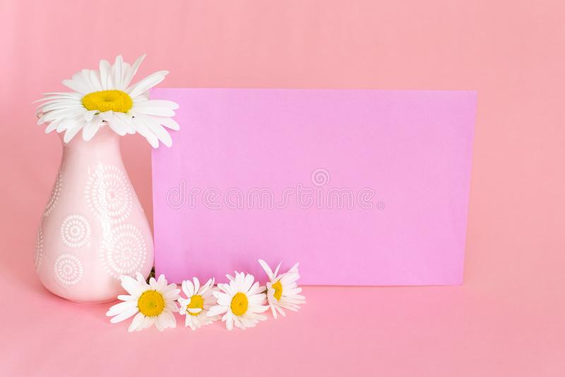 Soft pink light bathroom decor for advertising, design, cover. Cosmetic set on light dressing table. Beautiful flowers in a vase stock photos