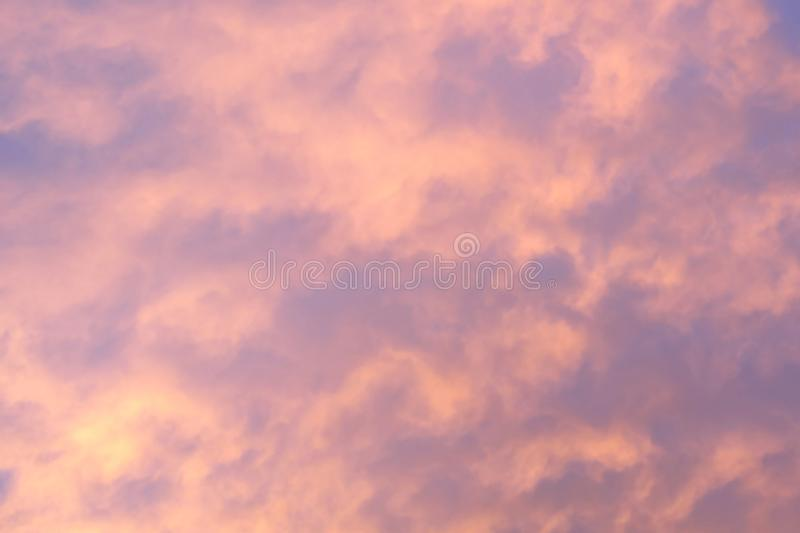Sunset with soft pink clouds royalty free stock photography