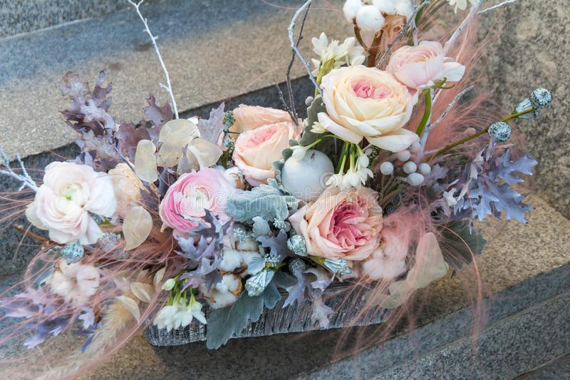 Soft pink wedding bouquet with peony and roses by florist close up stock photo