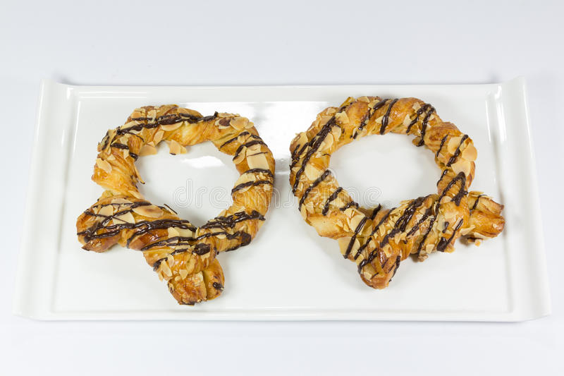 Soft pretzel. With chocolate souce on ceramic plate royalty free stock photo