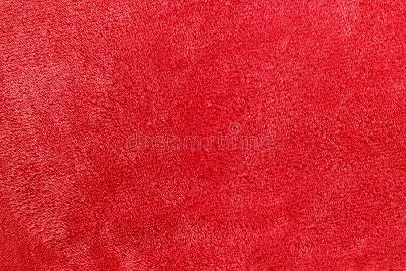 soft red micro fleece blanket background stock image