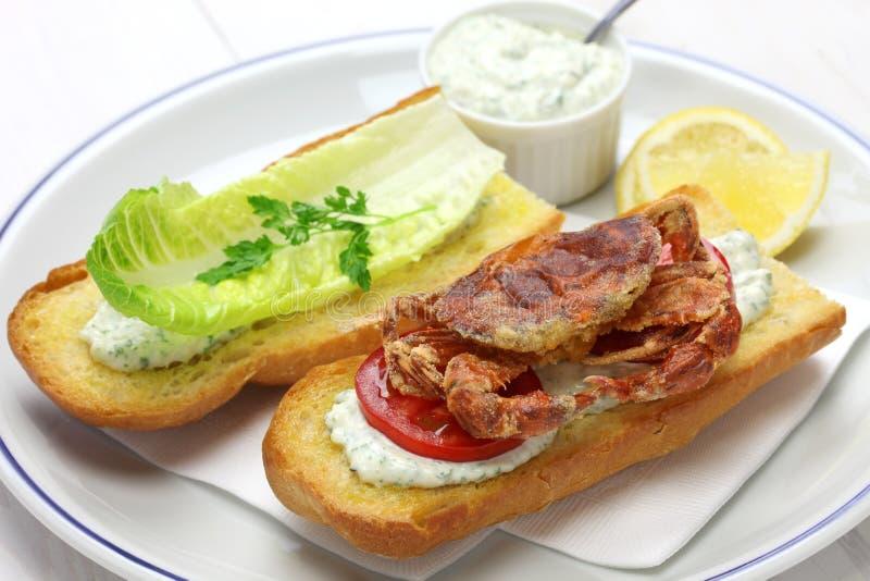 Soft shell crab po boy, cajun style submarine sandwich. Isolated on white background stock photos
