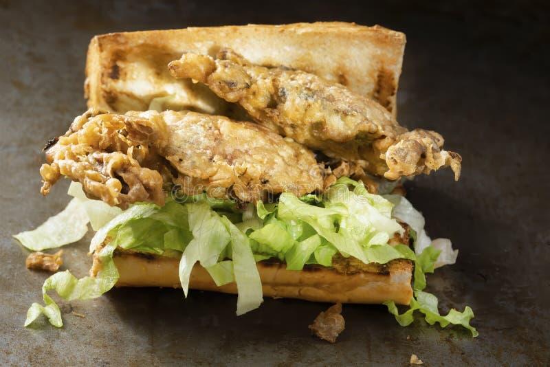Soft shell crab seafood po boy sandwich. Close up of soft shell crab seafood po boy sandwich stock image