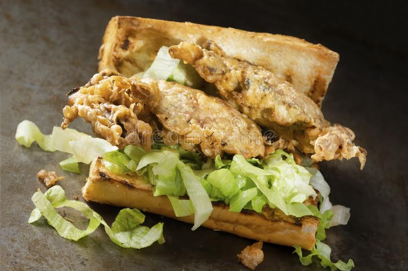 Soft shell crab seafood po boy sandwich. Close up of soft shell crab seafood po boy sandwich stock images