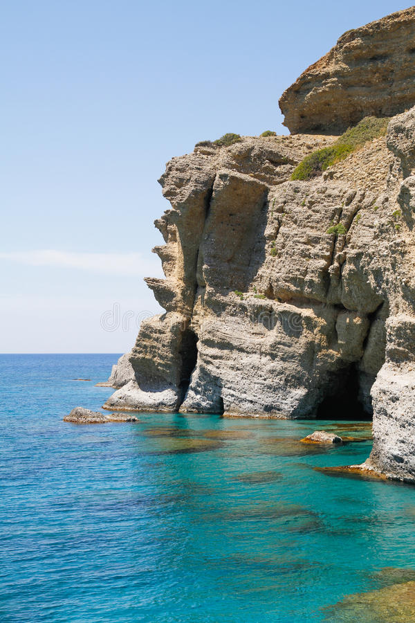 Soft steep pebble rock cliffs stock images