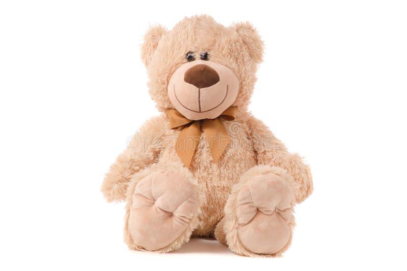 Soft toy beige bear. On white background isolation royalty free stock photography