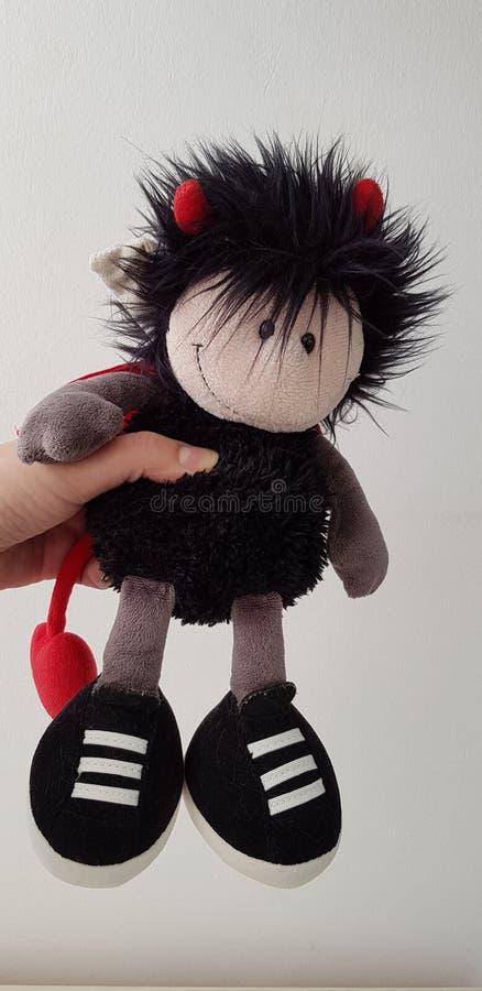Soft toy designed as boy devil on white background stock photography