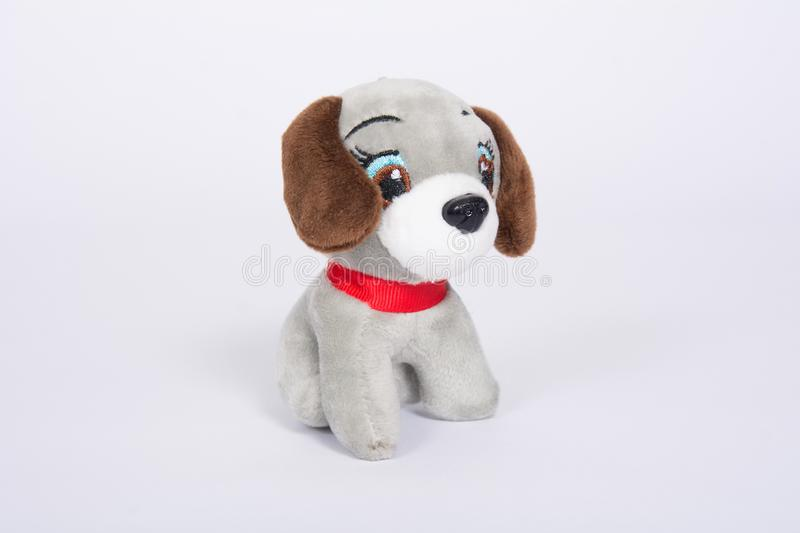Soft toy dog with brown ears on a white background.  stock photo
