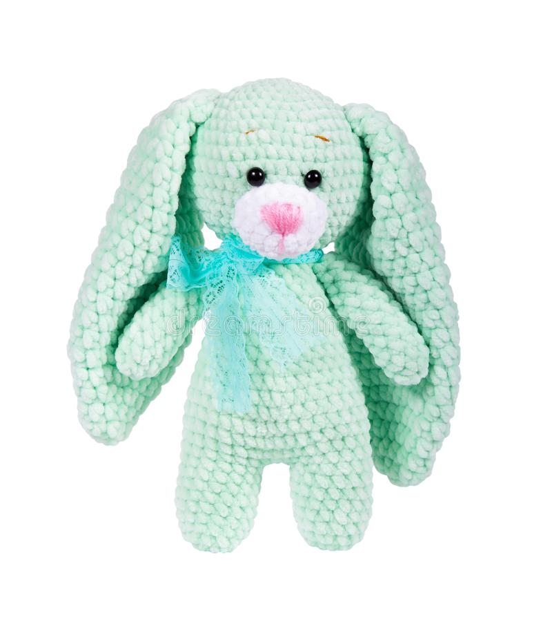 Soft toy knitted bunny. Isolated on white. Plush crocheted bunny. Soft toy knitted bunny. Isolated on white. Toy bunny. Plush crocheted bunny stock photos