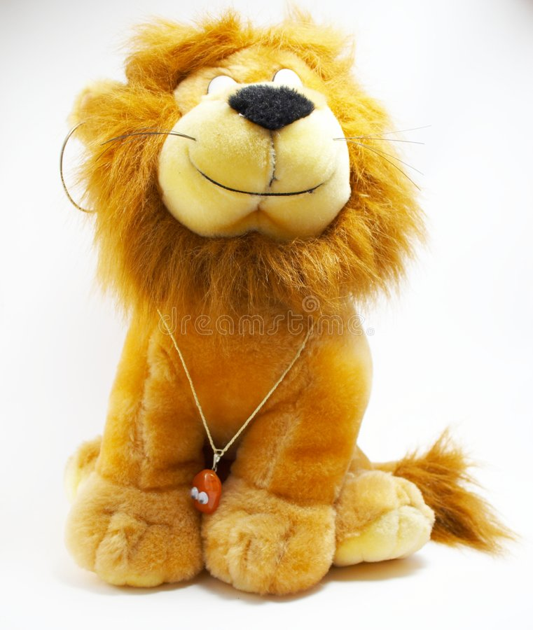 Soft toy - a lion. With ornaments royalty free stock images