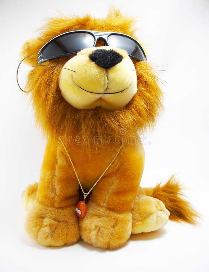 Soft toy - a lion. With ornaments royalty free stock photography