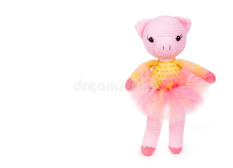 Soft toy pig. Knitted toy pig. Plush crocheted pig. Copy space stock images